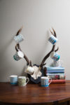 mugs on antlers